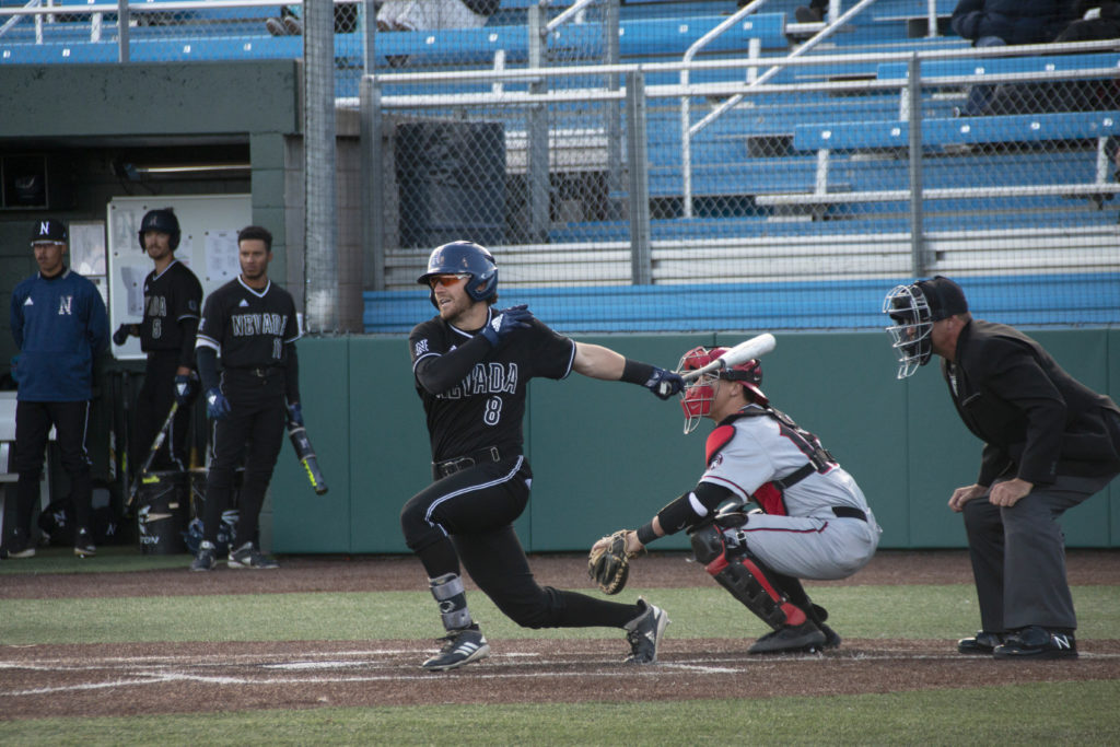 Josh Zamora swings at a pitch in a game versus San Diego State