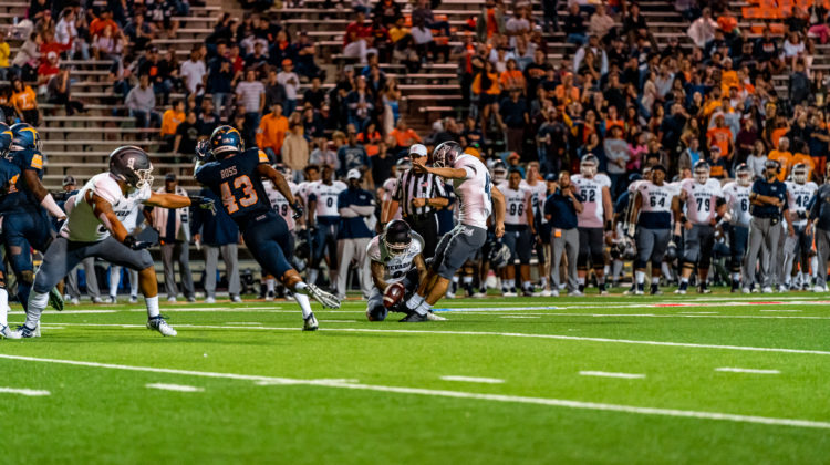 Freshman Brandon Talton kicks a field goal against UTEP on Sept. 21, 2019. Talton is wearing grey pants with a white jersey. His number, 43, is vaguely on his back.